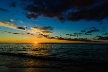 Sunset on a tropical beach. Reunion Island
