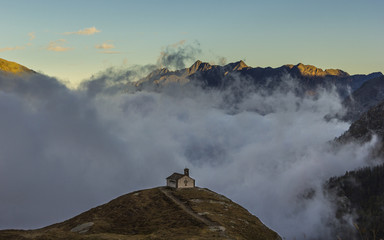 Ceresole Reale, Piedmont, Italy: Lonely church in the mountains, above the sea of fog.