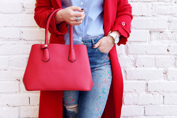 Fashion autumn outfit woman in red coat with leather bag