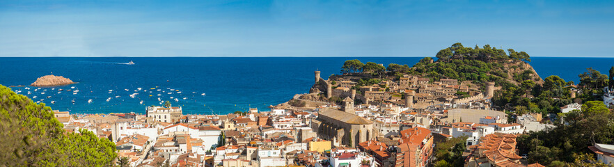 Panorama of the town of Tossa de mar one of the most beautiful towns on the Costa Brava. City walls and medieval castle on the hill.