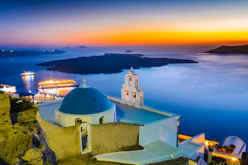 Firostefani, Santorini, Greece. Twilight with old greek church a
