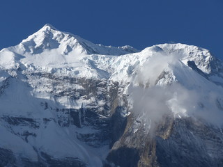 Summit of Annapurna covered by snow, view from Upper Pisang, Annapurna Circuit trek in Nepal