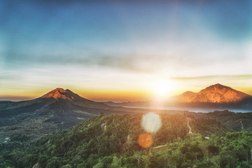 Active volcano Mount Gunung Batur at sunrise in Bali, Indonesia.