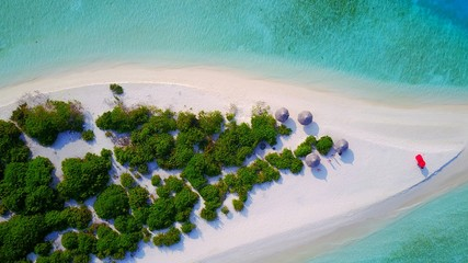 P01088 Aerial flying drone view of Maldives white sandy beach on sunny tropical paradise island with aqua blue sky sea water ocean 4k