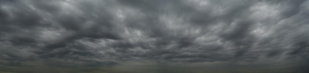 Dark clouds before a thunderstorm, tornado, hurricane, in the vast sky