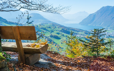 Autumn. A bench with a view of a wide mountain landscape.