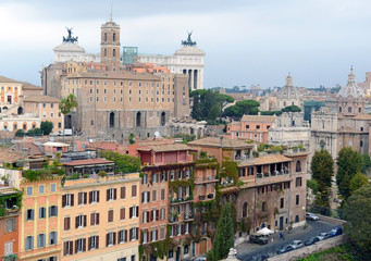 Cityscape with elevated view of city and commercial and residential buildings with tile rooftops in Rome, Italy