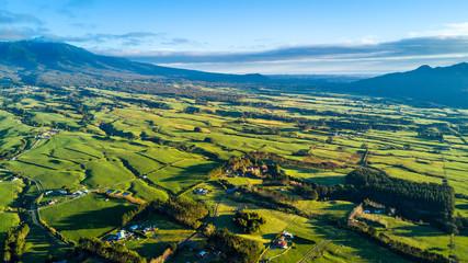 Aerial view on a farmland with stock paddocks at the foot of Mount Taranaki. Taranaki region, New Zealand