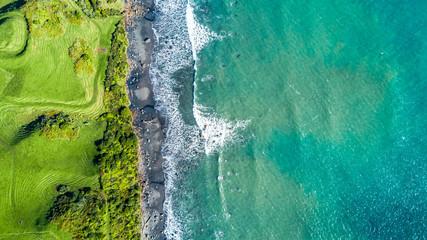 Aerial view on the coast of Tasman sea near New Plymouth at sunny day. Taranaki region, New Zealand.