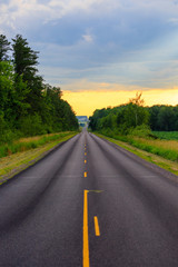 Long county highway in central Wisconsin late on a summer day