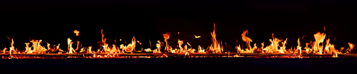 Horizontal fire flames with dark background