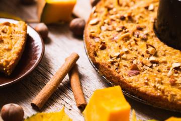 Pumpkin pancakes on a wooden background. Autumn food