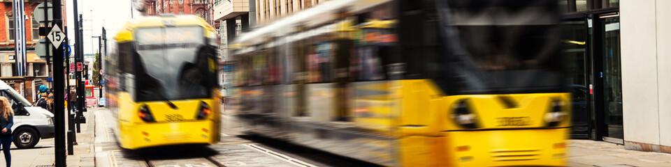Light rail tram in the city center of Manchester, UK