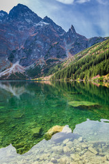 Colorful dusk at pond in the Tatra Mountains in autumn