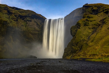 Seljalandsfoss waterfall in Iceland with mountains and blue sky