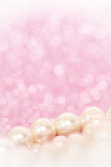 Pile of pearls on pink festive background