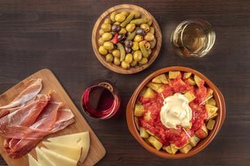 Tapas and wine. Patatas bravas, olives, jamon, cheese