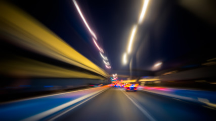 Motion blur of car moving inside tunnel