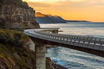 Sunset over the Sea cliff bridge along Australian Pacific ocean