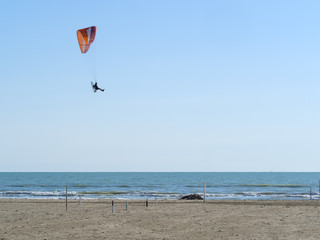 Paramotor or Powered Paragliding flying on the beach and sea