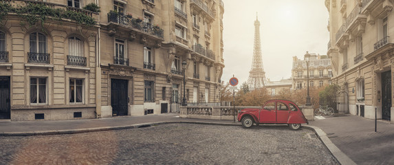 small street in paris with view on the famous eifel tower - panroama