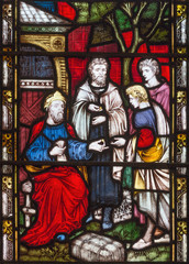 LONDON, GREAT BRITAIN - SEPTEMBER 19, 2017: The Parable of Talents on the stained glass in St Mary Abbot's church on Kensington High Street.
