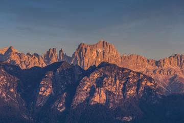 Autumnal sunset light on Catinaccio and Torri del Vaiolet peaks, Dolomites, Alto Adige/South Tyrol, Italy