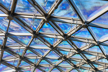 glass roof of building with views of the sky through the glass