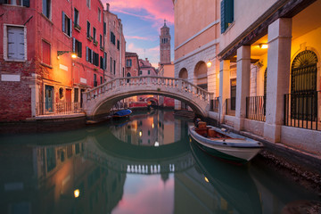 Venice. Cityscape image of narrow canals in Venice during dramatic sunset.