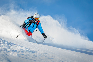 Male freeride skier in the mountains off-piste