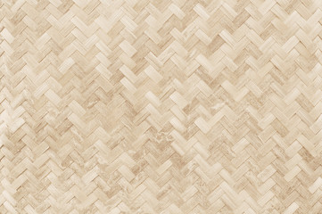 Old bamboo weaving pattern, woven rattan mat texture for background and design art work.