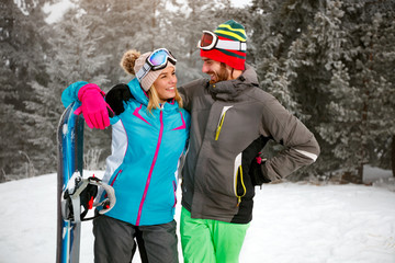 couple is having fun outdoors in winter mountain