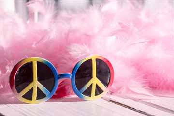 Hippie style: peace sign sunglasses and pink feather boa