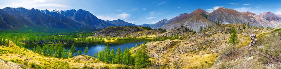 Panorama, mountains and mountain lake. Taiga, Altay, Russia.