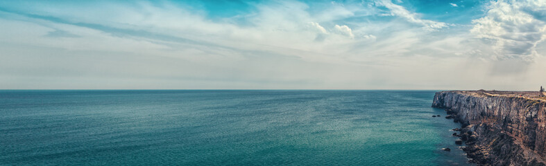 Portuguese coast  - Cliff into the Atlantic Ocean. View from Sagres fortress. Taken in Sagres, Faro, Algarve, Portugal.