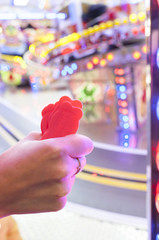 Woman hand with a fistfull of chips for fair ground ride childrens cars track