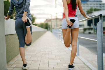 Two women stretching feet