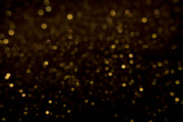 Golden and silver glitter backgound with bokeh abstract effect