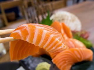 Salmon sashimi with chopsticks 1
