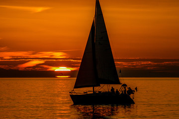 Sailboat at Florida Sunset in Gulf of Mexico.