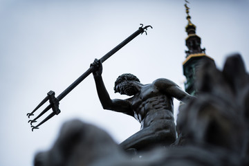 Close-up of Neptune's Fountain, in the center of Gdansk, Poland. Photo with shallow depth of field.