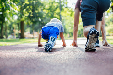 Father and son preparing to run