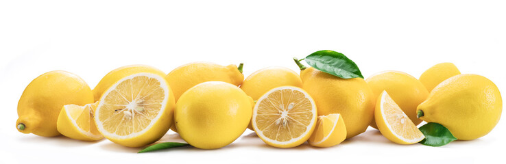 Lot of lemon fruits with lemon leaves isolated. Horizontal photo.