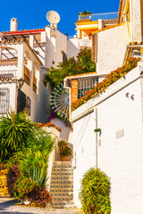 beautiful, picturesque street, narrow road, white facades of buildings, Spanish architecture