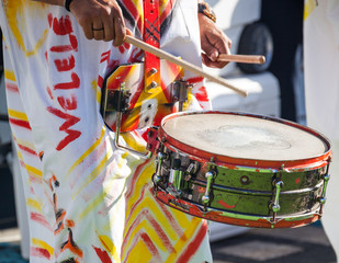 Drummer plays snare drum on caribbean island