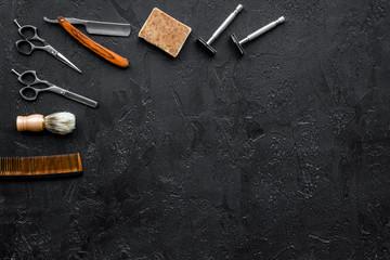 Vintage barbershop tools. Razor, sciccors, brush on black background top view copyspace