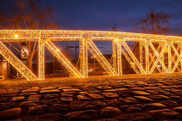 Christmas illumination in the shape of a bridge structure in Poznan.