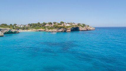 Drone aerial landscape of the beautiful bay of Cala Anguila with a wonderful turquoise sea, Porto Cristo, Majorca, Spain