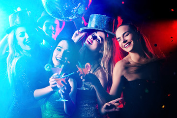 Dance party with group people . Dancing youth under influence of drugs. Women and confident casual smiling man have fun in night club. Seduce boozy woman cuddles up guy .