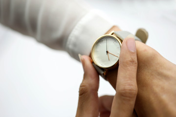 woman looking at her watch.